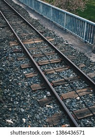 old metallic train tracks in the station in the street