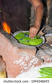 Old Mexican Lady Cooking Prickly Pear Cactus in traditional way - Traditional food - 24 September 2013 - Huatulco - Mexico