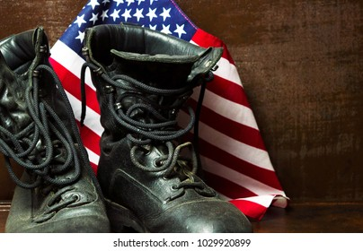 3ff6800b15cb Old military army boots and USA flag