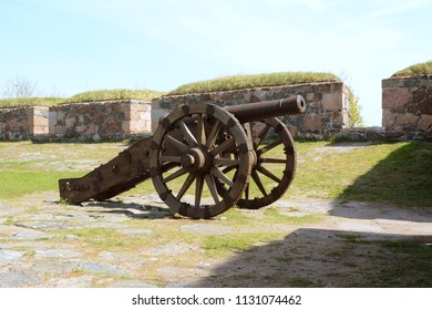 Old military cannon mounted on wheels, displayed in a bastion on sea fortress Suomenlinna, Helsinki