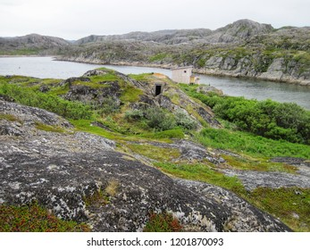 Old military fortifications. Coast of the Barents Sea. Russia.