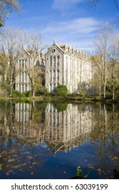 The old military headquarters and high school college building reflected over the lake at Parque D. Carlos I, in Caldas da Rainha, Silver Coast, Portugal