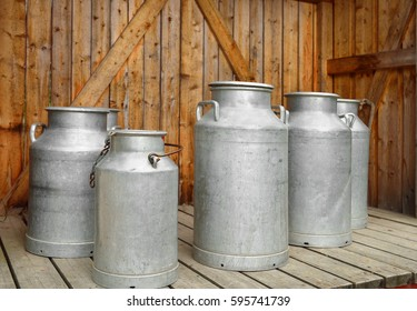Old milk cans on dairy farm