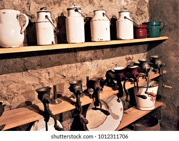 old milk mills and grinders,  in the kitchen of a rural house in Galicia, old wooden furniture, old food storage containers, typical rural cuisine of Galicia, Galician ethnographic museum,
