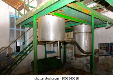 Old milk storage tanks. Premises of a destroyed and plundered milk production plant. The raiders captured the plant. Vandalism. Ukraine, January 2018.