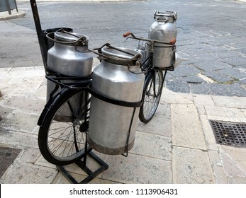 Old milkman's bicycle 1940 year with aluminum containers for fresh milk transport