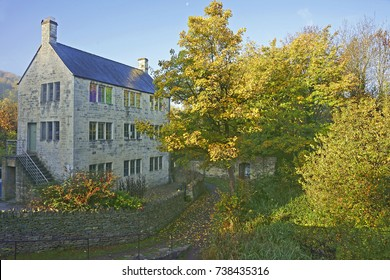 An old mill and Autumn along the disused Stroud water canal at Brimscombe, near Stroud, The Cotswolds, Gloucestershire, UK