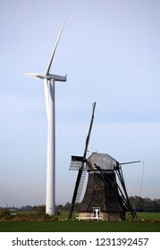 Old mill and modern wind turbine, Holland