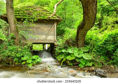 Old mill on the bank of mountain spring, waiting for engagement