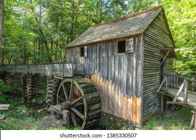 Old mill powered by water by using wooden water wheel