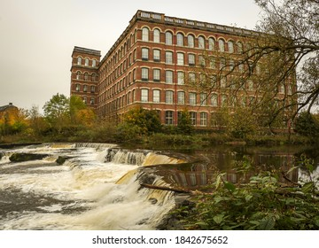 An old mill relected in White Cart Water.