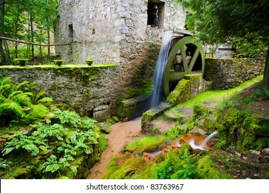 Old mill and a spinning water wheel