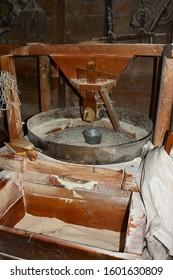 old millet corn flour is milled under a millet wheel