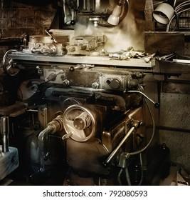 Old milling machine in a workshop. In vintage warm tones.