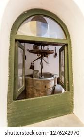 Old millstone inside the cloister of San Gregorio Armeno, Naples Italy