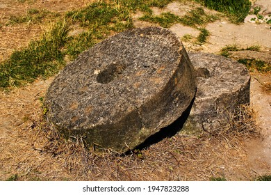 Old millstones or stone grinding wheels