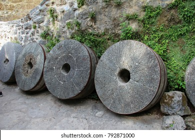 Old millstones. A traditional European tool to mill the flour.
