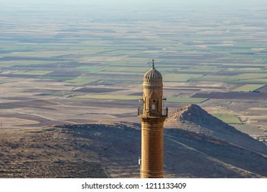 Old minaret in the city of Mardin Turkey, against the backdrop of the valley of Mesopotamia