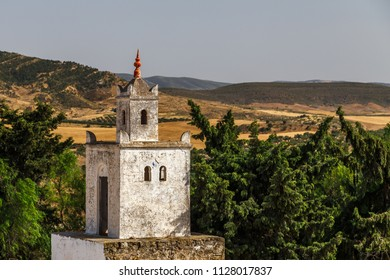 Old minaret of the mosque built over ruins of the ancient Uthina (Oudna, Oudhna) town, Tunisia