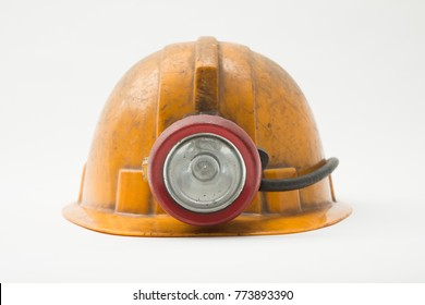 Old miner helmet with lamp on white background