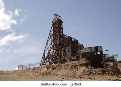 Old mining headframe and mill building, Cripple Creek Mining District, Colorado, taken May 2005.