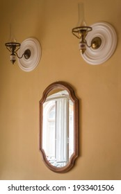 Old mirror on the wall and two lamps in a vintage style room