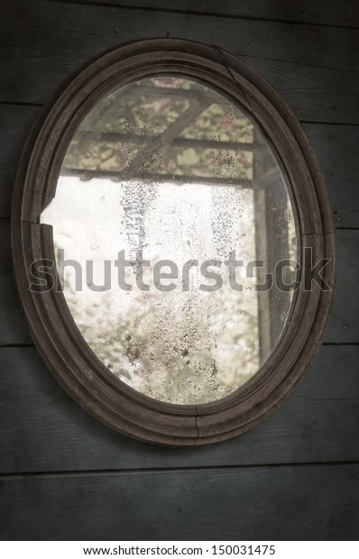 Old mirror in a wooden frame. Vintage  photo.