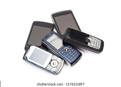 Old mobile phones in a cut out view