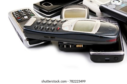 old mobile phones in a pile