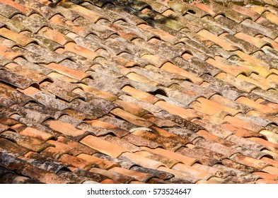 Old and moldy roof texture, poorly arranged and some broken tiles.