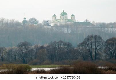 Old monastery under the cloudy sky in fog . Novhorod-Siverskyi, Chernihiv region in Ukraine. Horizontal outdoors shot.