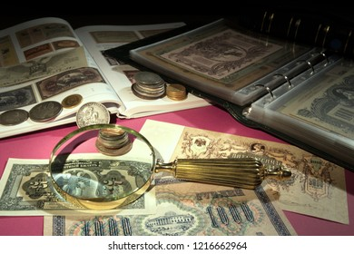 Old moneys and coins through a magnifying glass. Numismatics and collecting money.Russian Empire