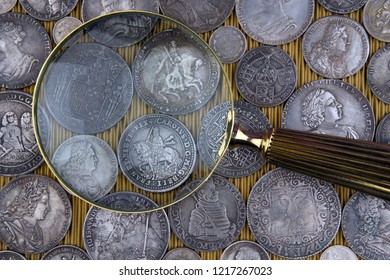 Old moneys and coins through a magnifying glass. Numismatics and collecting money.Russian Empire and world currency.Silver,gold.
