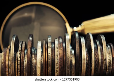 Old moneys and coins through a magnifying glass. Numismatics and collecting money.Russian Empire and world currency.Silver,gold.Coat of arms