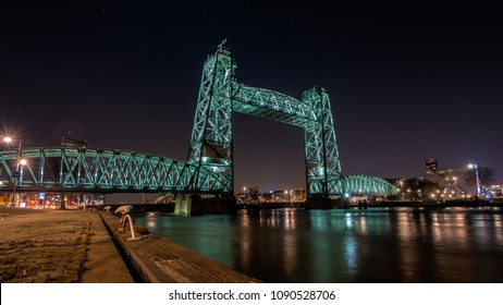 Old monumental railroad bridge called De Hef in Rotterdam beautiful lit during the night