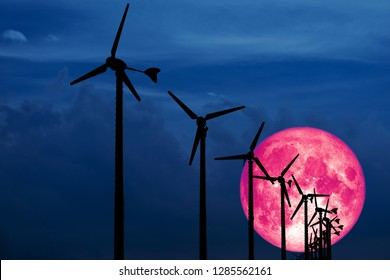 Old moon back Wind turbines produce wind energy which is a clean energy to replace coal and oil energy, Elements of this image furnished by NASA