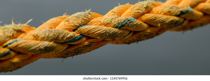 Old mooring heavy ropes in the port of Saint Lucia. Mooring rope anchoring a ship.