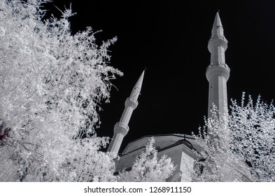 old mosque cami camii double minaret infrared photo church with snowy trees