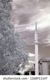 old mosque cami camii minaret infrared photo church with snowy trees