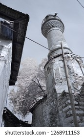 old mosque cami camii minaret infrared photo church religion religious with snowy trees