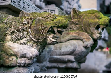 Old moss-grown statues of mythological animals - decoration of hindu temple Pura Gunung Lebah in Ubud town on Bali, Indonesia