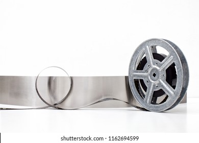 old motion picture film reel on white background