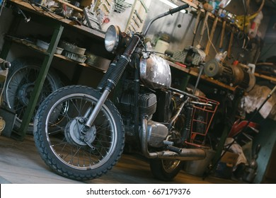 Old motorcycle, which needs to be repaired, in the workshop