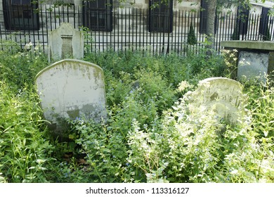 The old and mottled tombstone in the cemetery