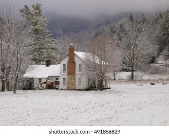 old mountain house in snow