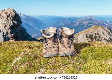 Old mountaineering boots on a top of a mountain