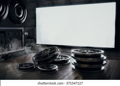 Old movie camera and film cartridge on a wooden table and a blank movie screen, mock up 3D Render