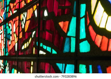 Old multicolored stained glass window.