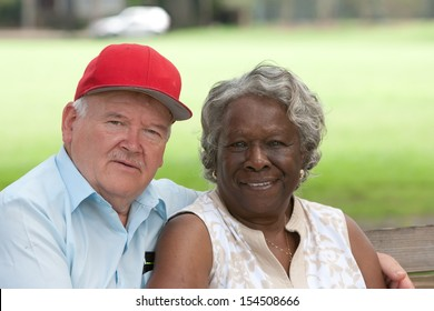 Old multiracial couple outdoors during the summer