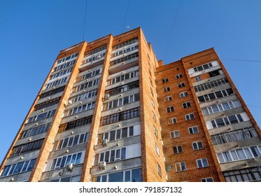 Old multistory apartment building. Soviet skyscraper. Brick building. Residential